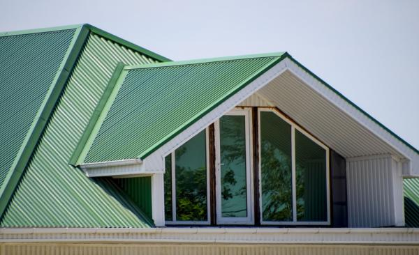 Attic window surrounded by green Colorbond roofing