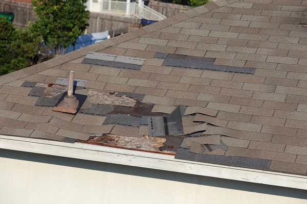 Warped and broken roof tiles after a storm